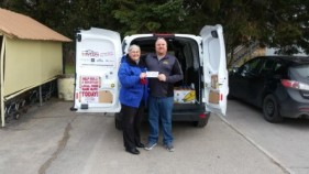 Lions Club donation to the Food Bank presented by Lion Jim Summers