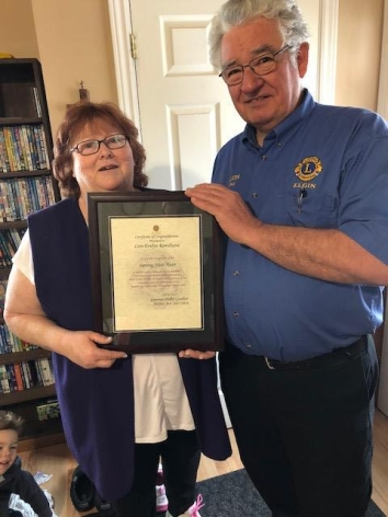 The Governor's Award of Achievement presented to Evelyn Ramdhanie by current Elgin Lion club President Paul Waenink